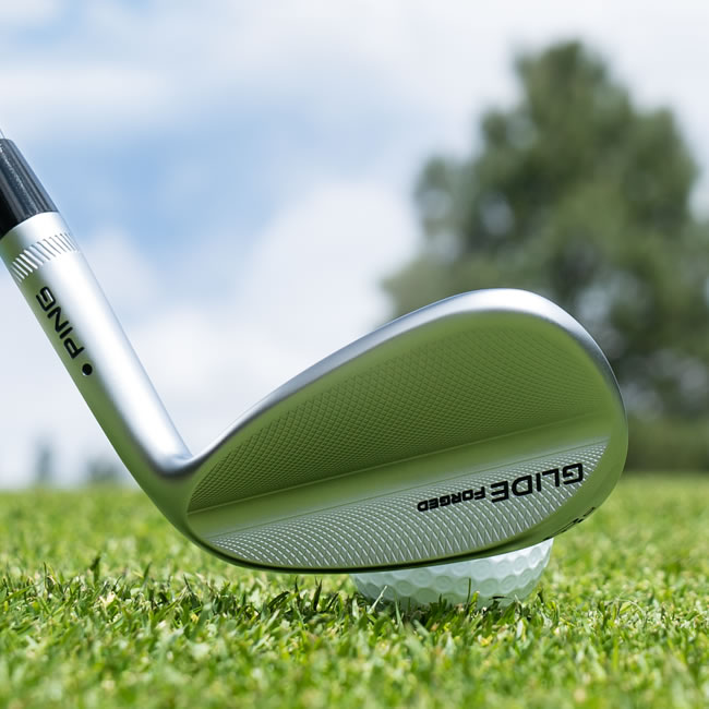 Glide Forged wedge behind ball in grass
