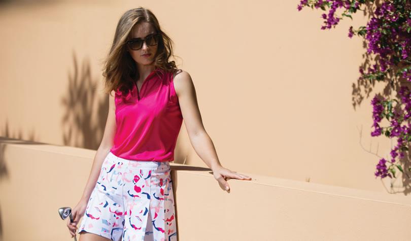 female golfer wearing Dee top in Hot Pink
