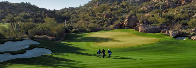 Image of golfers walking down the fairway.
