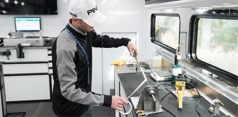 Technician regripping a club inside the Tour Truck
