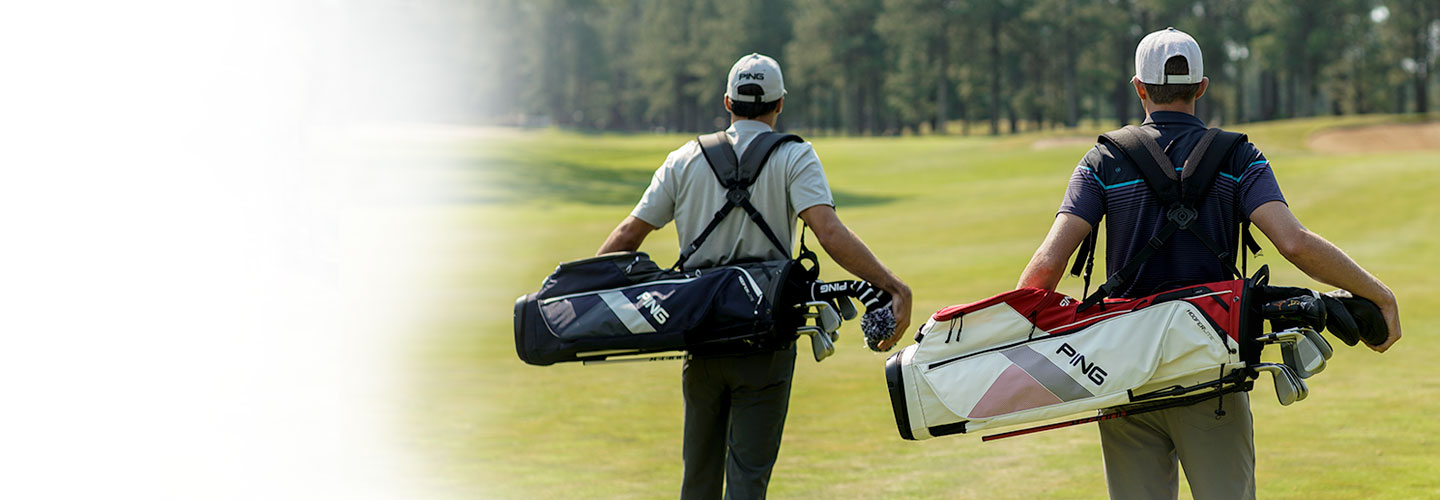 Two men carrying Hoofer carry bags on a golf course